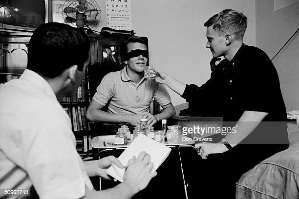 During a sleep deprivation experiment American student Bruce McAllister takes notes while Randy Gardner describes scents offered to him by Joe...