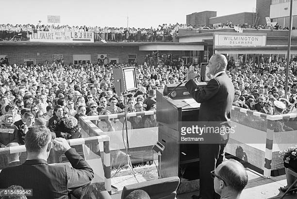 During a speech to a large crowd President Lyndon B Johnson urges voters to join him in an 'American breakthrough' Later the Chief Executive left for...
