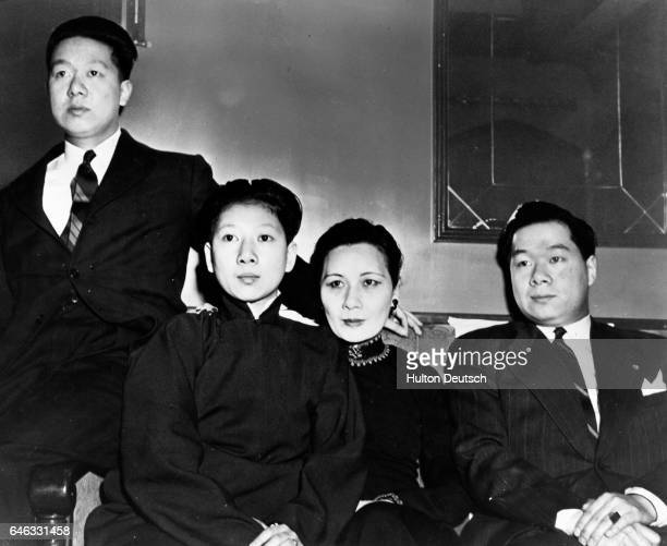 During a tour of the United States prominent sociologist Madame Chiang KaiShek and members of her party pose for the camera in her special railroad...