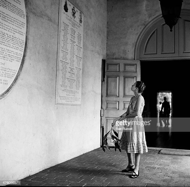 During a tour of the Wren Building at the College of William and Mary a girl stands back to read a sign Williamsburg Virginia 1949