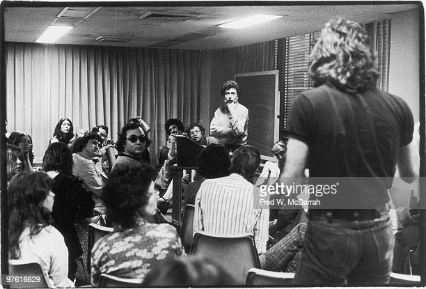 During a Village Voice newspaper union meeting American journalist and music critic Nat Hentoff stands at a lecturn and listens to an unidentified...