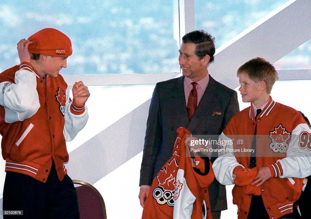 During A Visit To The Pacific Marine Heritage Legacy Prince Charles And His Sons, Prince William And Prince Harry, Were Presented With Bright Red 'roots' Canadian Olympic Jackets And Baseball Caps. Showing His Sense Of Humour, Prince William Has Decided To Put His Hat On Back To Front.