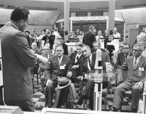 During a visit to the Saturn blockhouse of Cape Kennedy's Launch Complex, American politician US President Lyndon B Johnson and NASA officials, among...