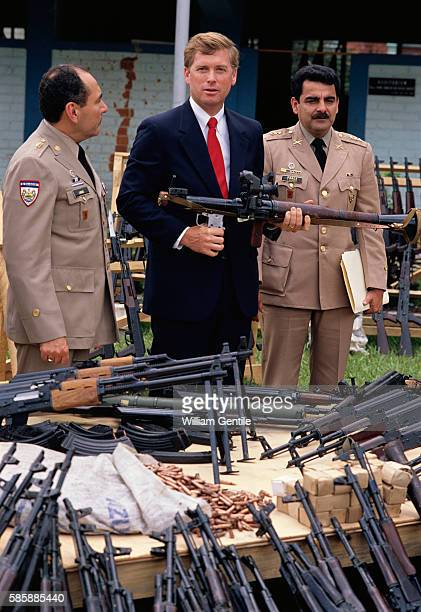 During a visit with El Salvador's military leaders Vice President Dan Quayle holds a grenade launcher that was allegedly seized from antigovernment...