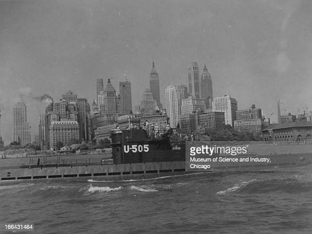 During a War Bonds tour the captured German submarine U505 sails past Battery Park in lower Manhattan New York New York with the New York skyline...