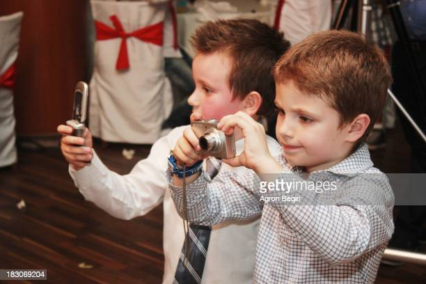 During a wedding that I was shooting in Kosovo I had these two little colleagues wich were really concentrated in their job