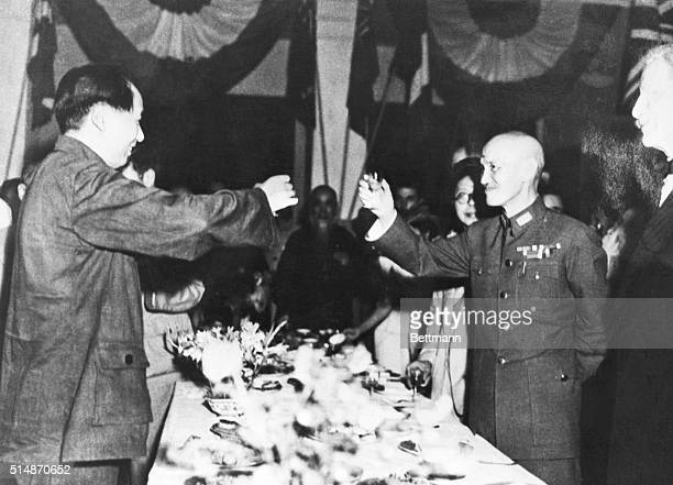 During a welcoming party for Mao Zedong, General Chiang Kai-shek toasts with Mao over the banquet table.