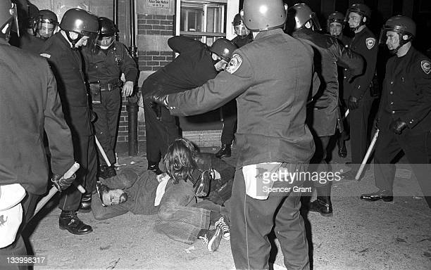 During an antiwar demonstration in Harvard Square riot gear clad police assault demonstrators with batons Cambridge Massachussetts April 1970