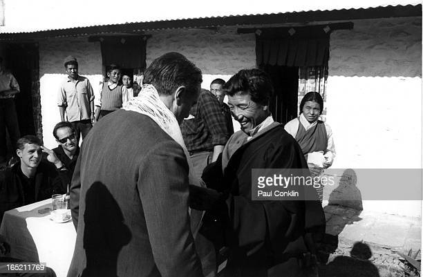 During an aroundtheworld trip to visit Peace Corps volunteers Peace Corps founder and president Sargent Shriver receives a white Buddhist prayer...