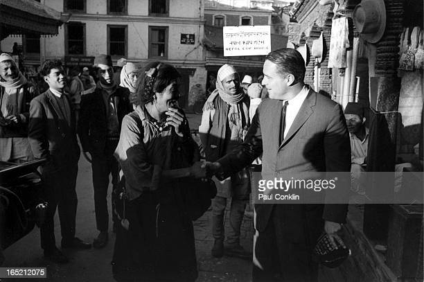 During an aroundtheworld trip to visit Peace Corps volunteers Peace Corps founder and president Sargent Shriver meets with locals Kathmandu Nepal 1964