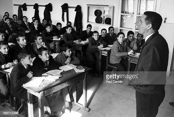 During an aroundtheworld trip to visit Peace Corps volunteers Peace Corps founder and president Sargent Shriver speaks with students in an English...
