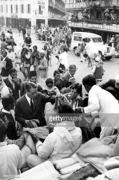 During an aroundtheworld trip to visit Peace Corps volunteers Peace Corps founder and president Sargent Shriver and Barbara Stebbins look at a...
