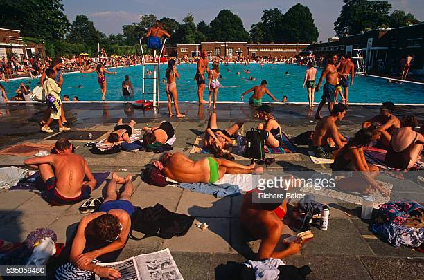 During an August heatwave the population of Brixton and many others from all over London bask in the glorious weather at the Brockwell Lido in...