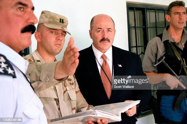 During an on-site visit to Iraqi police headquarters, American Interior Minister of the Iraqi Coalition Provisional Authority and former law...