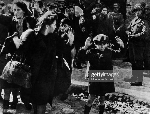 During an SS search in the ghetto Jews surrendering to the German soldiers Warsaw Ghetto Uprising Warsaw April 1943