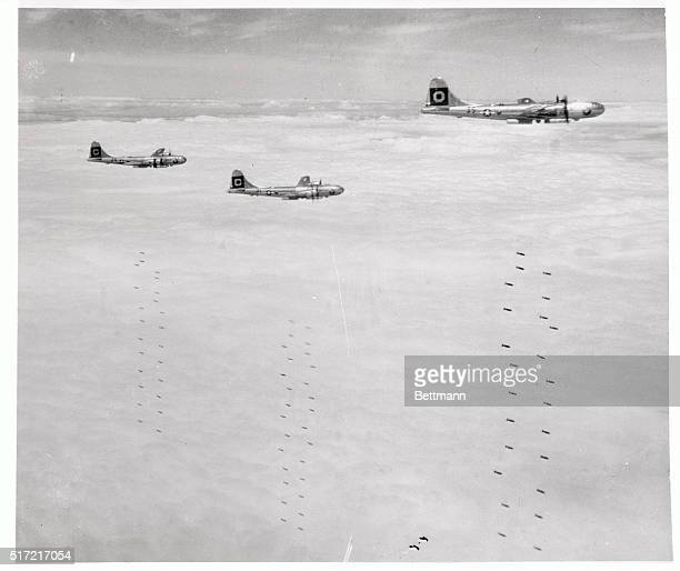 During another all-out raid on installations on the Jap homeland, B-29's let loose their bomb loads over the target. While some 20th Air Force planes...
