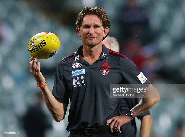 during Bombers coach James Hird looks ahead while spinning a ball during the round three AFL match between the Fremantle Dockers and the Essendon...