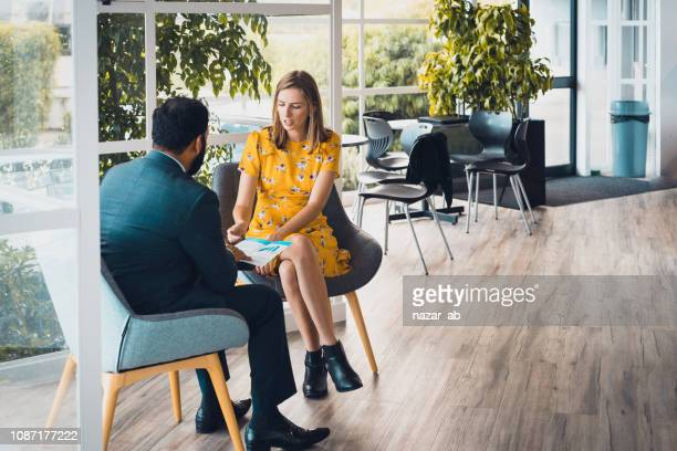 during consultation. - advice stock pictures, royalty-free photos & images