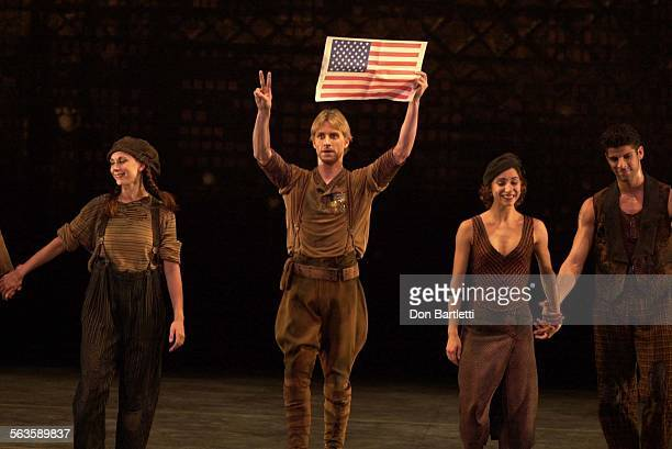During curtain call after the performance of Black Tuesday at the San Diego Civic Theatre American Ballet Theatre dancer Ethan Stiefel holds high a...