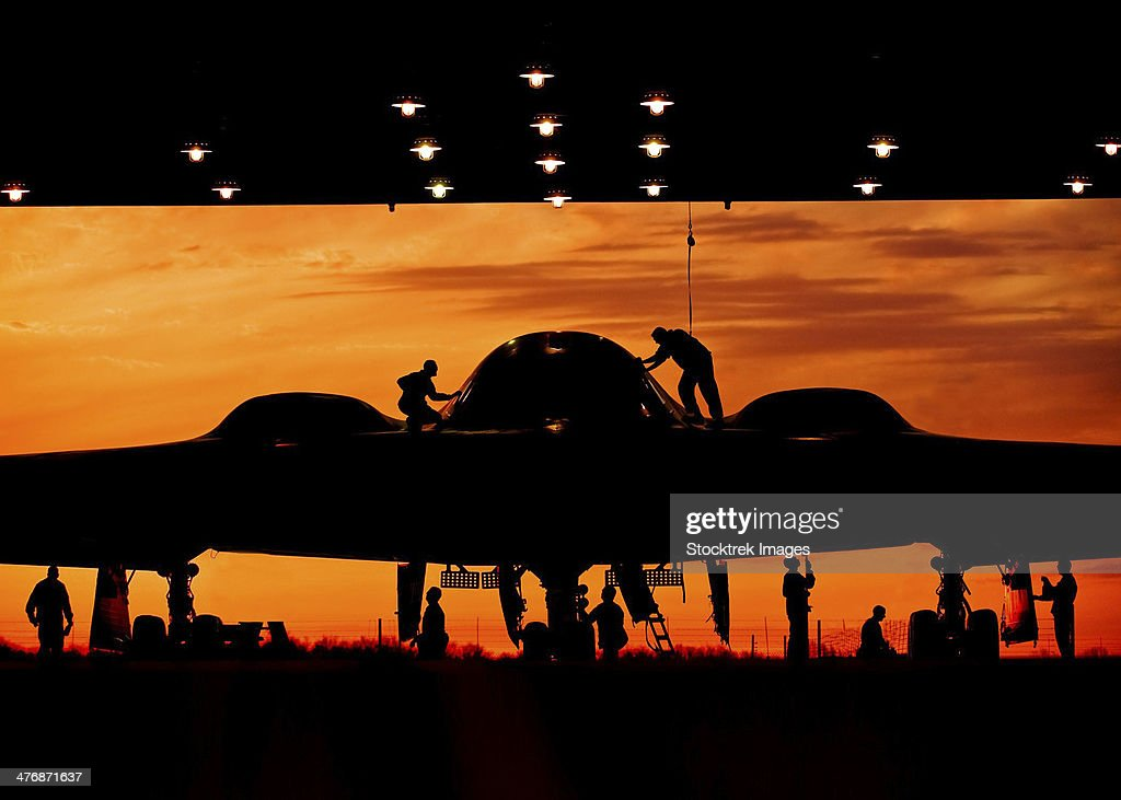 During early morning operations, 131st Bomb Wing Missouri Air National Guard mantainers service a B-2 Spirit stealth bomber at Whiteman Air Force Base, Missouri. : Stock Photo
