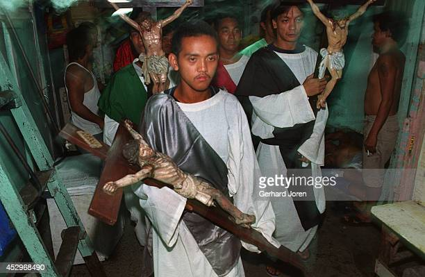During Easter week, crucifixes are carried around the jail, in a ritual hoped to bring the inmates good blessings. On Good Friday, 200 inmates...