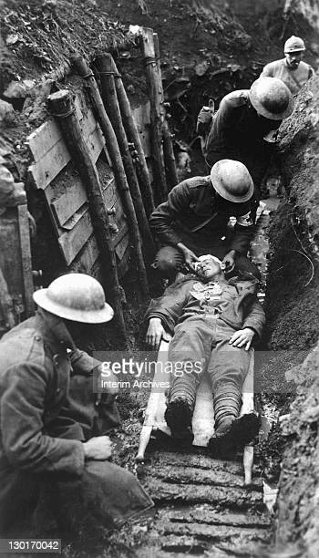 During fighting in the First World War a United States Marine receives first aid before being sent to the hospital in the rear of the trenches Toulon...