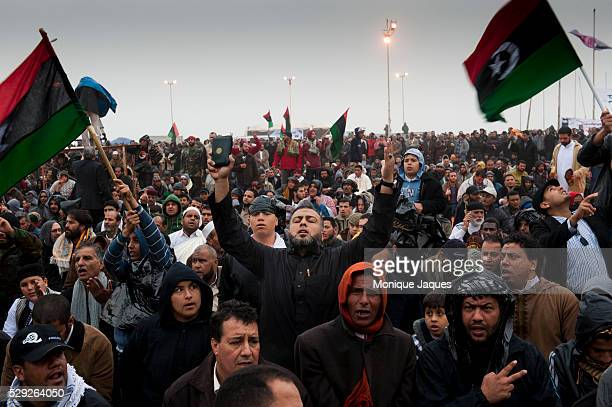 During Friday Prayers in front of Benghazi's downtown courthouse, men and women pray for safety and for the end of Gaddafi's reign. After a violent...