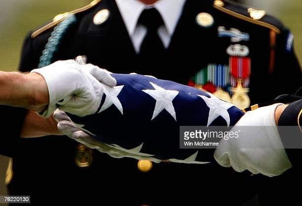During funeral services for Army Sgt 1st Class Jeffrey Duane Kettle of Texas City Texas members of an honor guard fold an American flag that rested...