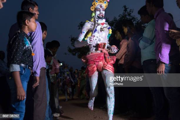 During gajan a devotee is performing on the road with a sharpedged weapon in his hand in Burdwan India on 13 April 2017 quotGajanquot is one of the...