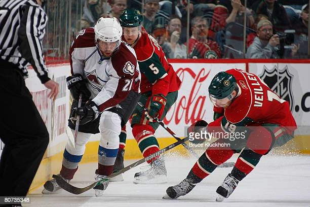 During Game Five of the Western Conference Quarter-Final of the Stanley Cup Playoffs Kim Johnsson and Stephane Veilleux of the Minnesota Wild attempt...