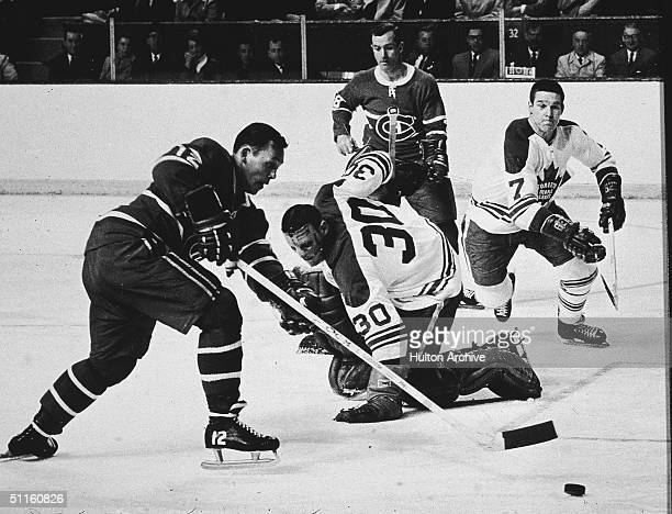 During game one of the 1967 Stanley Cup finals, Toronto Maple Leafs goalkeeper Terry Sawchuk watches as Montreal Canadien Yvan Cournoyer as Maple...