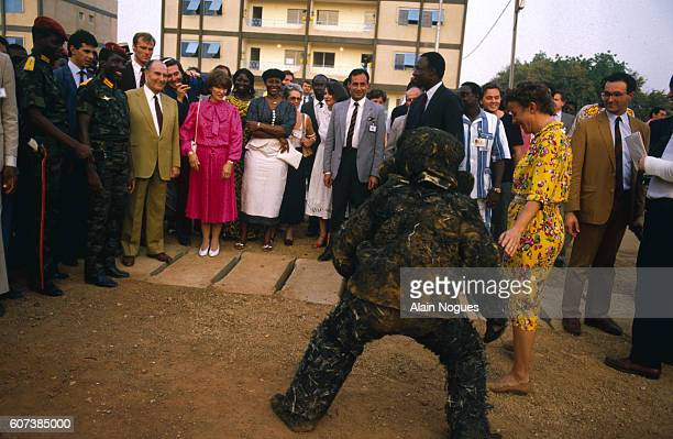 During his official visit to Burkina Faso French President Francois Mitterrand and his wife Danielle visit a local market with Burkina Faso President...