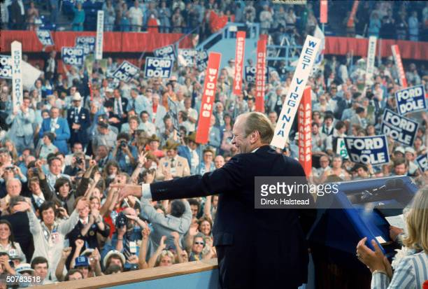During his reelection campaign American President Gerald Ford greets the cheering crowd pointing out specific individuals at the Republican National...