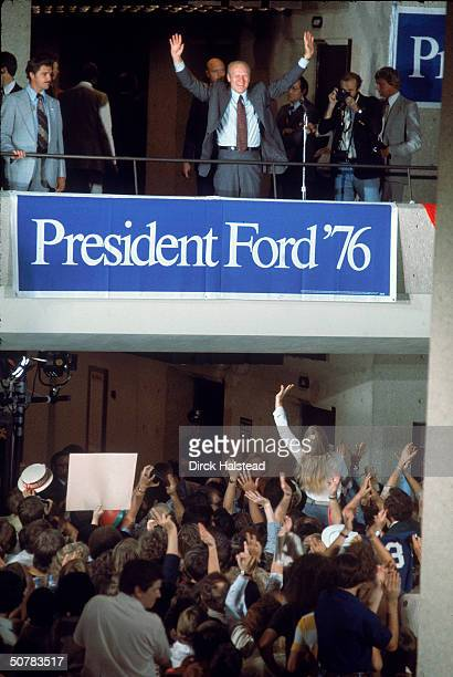 During his reelection campaign American President Gerald Ford stands on a balcony and waves to crowd at the Republican National Convention Kansas...