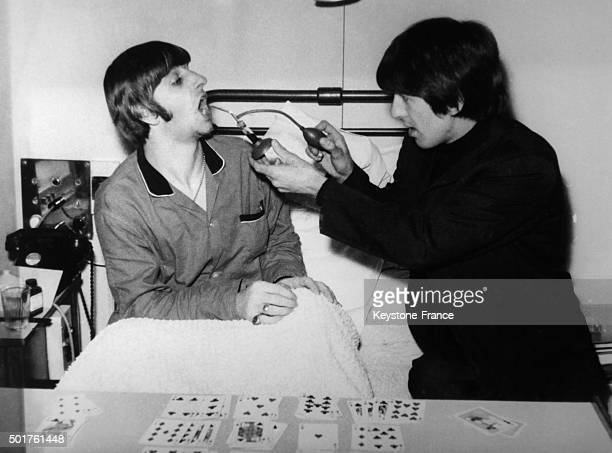 During his stay at the University College Hospital for the removal of his tonsils Ringo Starr gets the visit of Beatle George Harrison on December 5...