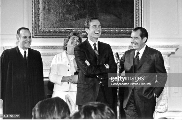 During his swearingin ceremony as United States Ambassador to the United Nations former Senator George HW Bush shares a laugh with from left US...