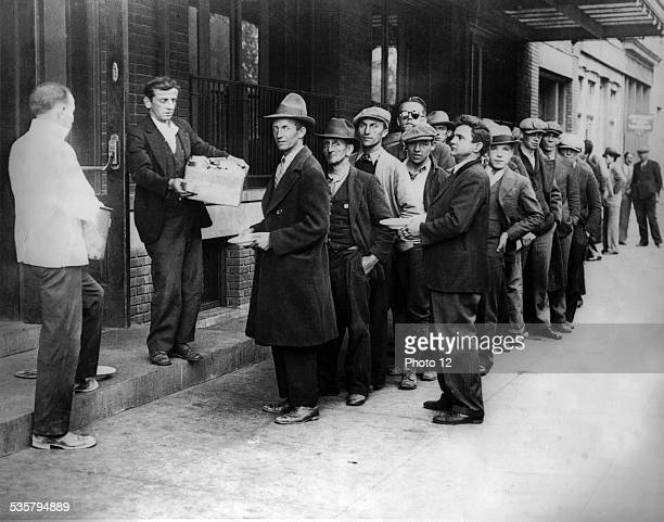 During Hoover's presidential term of office free meals are distributed in Washington Line in front of 'soup kitchens' c1930 United States National...