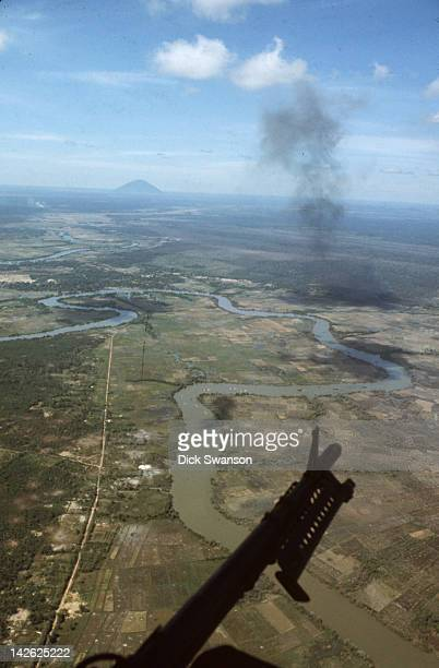 During Operation Cedar Falls, view from a US Army helicopter gunship during the evacuation of the so-called Iron Triangle village of Ben Suc,...