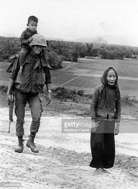 During peace negotiations between North and South Vietnam a Vietnamese soldier carries a tired little boy on his shoulders in South Vietnam The local...