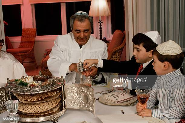 During Seder young Lewis Silberman performs a handwashing ritual on Rabbi Jack Frankel The Seder is celebrated during the first two days of Passover...