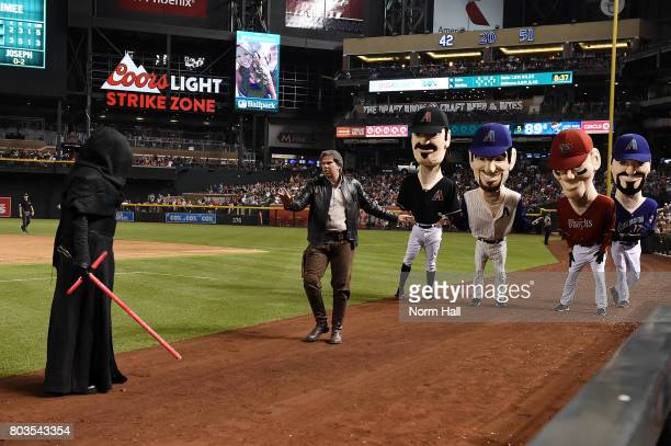 During Star Wars Night a Han Solo character stops the Legends Race to fight with a Sith character during a game between the Arizona Diamondbacks and...