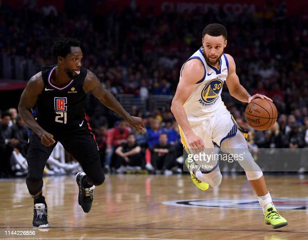 during Stephen Curry of the Golden State Warriors drives to the basket past Patrick Beverley of the LA Clippers a 113105 Warrior win in Game Four of...