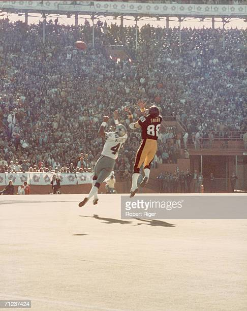 During Super Bowl X American football players Lynn Swann of the Pittsburgh Steelers and Mark Washington of the Dallas Cowboys both leap to catch a...