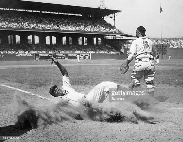During the 12th annual East-West All-Star Game of the Negro Leagues, American baseball player Josh Gibson , of the East team, creates a cloud of dust...