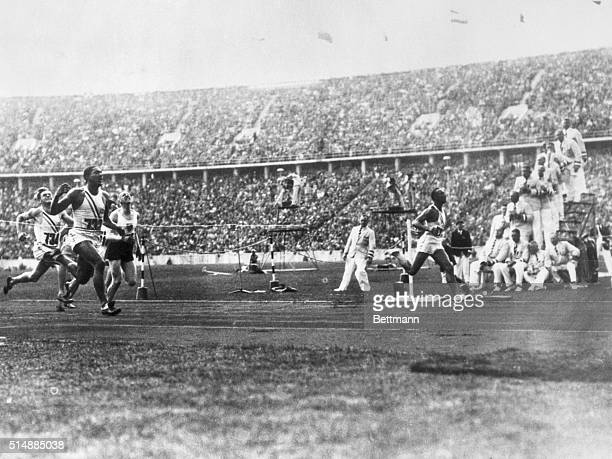 During the 1936 Olympic Games in Berlin Jesse Owens of Ohio State University breaks the tape to win gold in the 100meter dash in a record time of 103...
