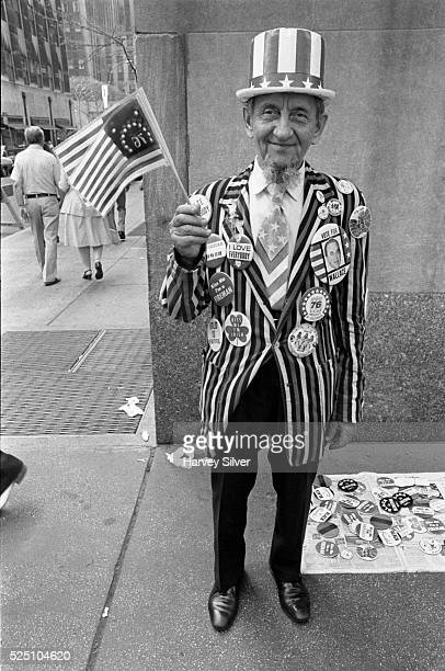 During the 1976 US Bicentennial a man dressed as Uncle Sam sells political buttons including a large one reading 'Vote for Wallace'