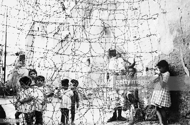 During the Algerian War following terrorist attacks by the NLF French authorities set up barbed wire in Tlemcen in July 1956 so as to prevent...