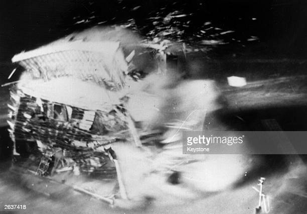During the atom bomb tests at Nevada, a house completely disintegrates, caused by the atom blast at Yucca Flat. Its destruction is filmed by a motion...