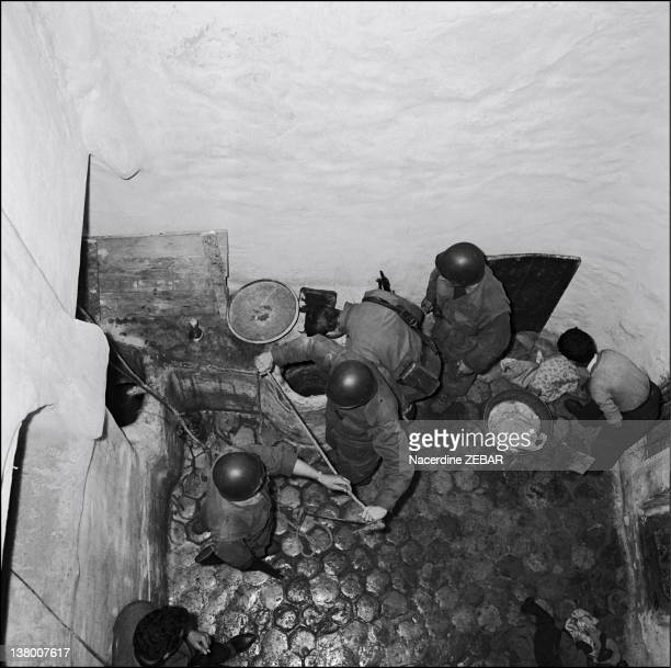 During the Battle of Algiers French paratroopers in streetbystreet sweeps of the Casbah are searching for arms caches of FLN's activits during June...