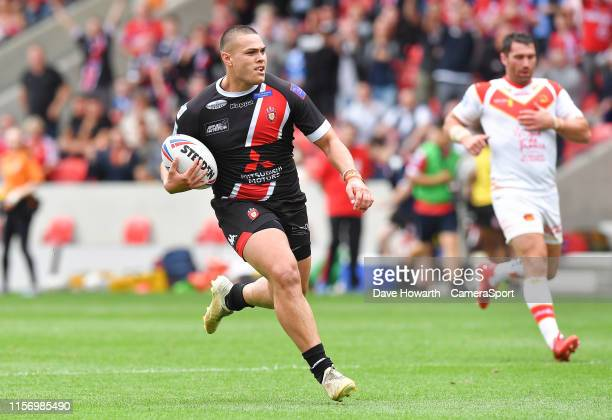 Salford Red Devils' Tui Lolohea runs in his first try as a Salford player SALFORD ENGLAND JULY 21 during the Betfred Super League Round 23 match...
